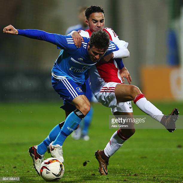 Nicolai Mueller of Hamburg is challenged by Nouri Abdelhak of Ajax of Ajax during a friendly match between Hamburger SV and Ajax Amsterdam at Gloria...