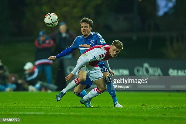 Nicolai Mueller of Hamburger SV and Daley Sinkgraven of Ajax Amsterdam battle for the ball during the Friendly Match between Hamburger SV and Ajax...
