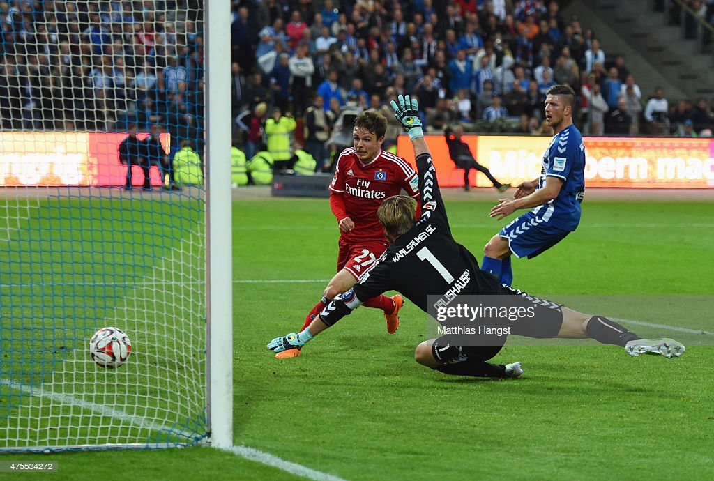 <a gi-track='captionPersonalityLinkClicked' href=/galleries/search?phrase=Nicolai+Mueller&family=editorial&specificpeople=2344337 ng-click='$event.stopPropagation()'>Nicolai Mueller</a> of Hamburger SV (27) beats goalkeeper Dirk Orlishausen of Karlsruher SC to score their second goal during the Bundesliga play-off second leg match between Karlsruher SC and Hamburger SV on June 1, 2015 in Karlsruhe, Germany.