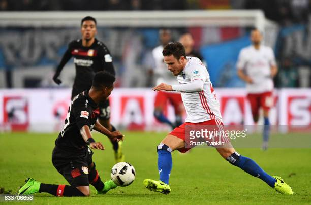 Nicolai Mueller of Hamburger SV is challenged by Wendell of Bayer Leverkusen during the Bundesliga match between Hamburger SV and Bayer 04 Leverkusen...