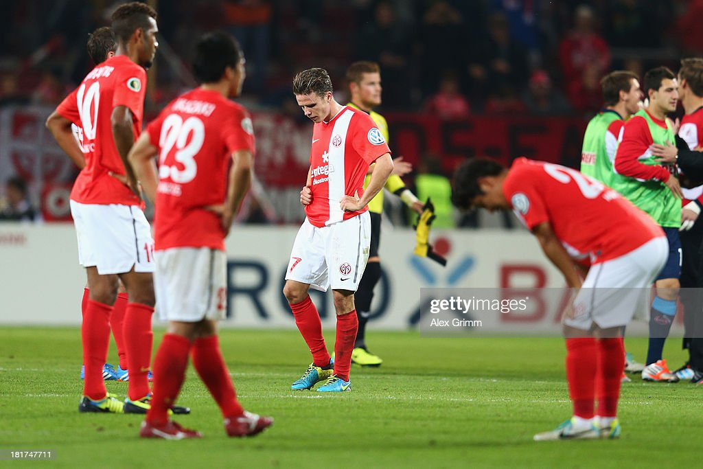 <a gi-track='captionPersonalityLinkClicked' href=/galleries/search?phrase=Nicolai+Mueller&family=editorial&specificpeople=2344337 ng-click='$event.stopPropagation()'>Nicolai Mueller</a> (back) of Mainz and team mates react after the DFB Cup second round match between 1. FSV Mainz 05 and 1. FC Koeln at Coface Arena on September 24, 2013 in Mainz, Germany.