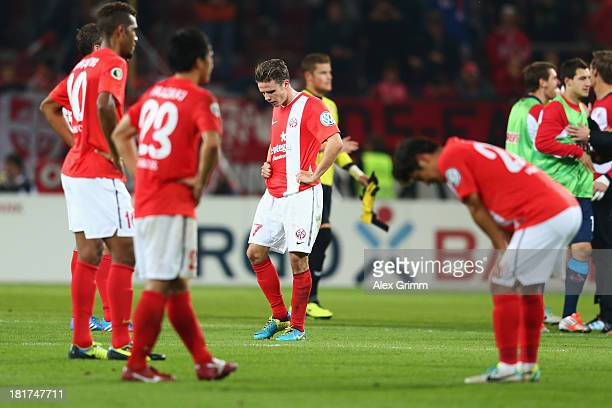 Nicolai Mueller of Mainz and team mates react after the DFB Cup second round match between 1 FSV Mainz 05 and 1 FC Koeln at Coface Arena on September...