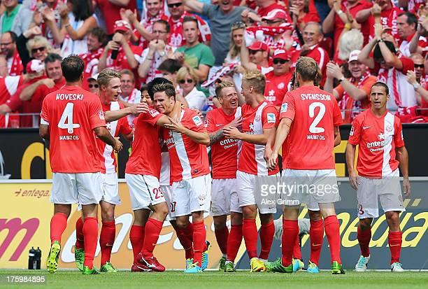 Nicolai Mueller of Mainz celebrates his team's first goal with team mates during the Bundesliga match between 1 FSV Mainz 05 and VfB Stuttgart at...
