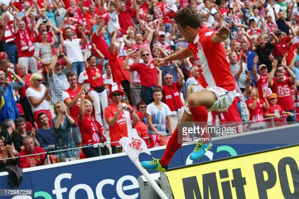 Nicolai Mueller of Mainz celebrates his team's third goal during the Bundesliga match between 1 FSV Mainz 05 and VfB Stuttgart at Coface Arena on...