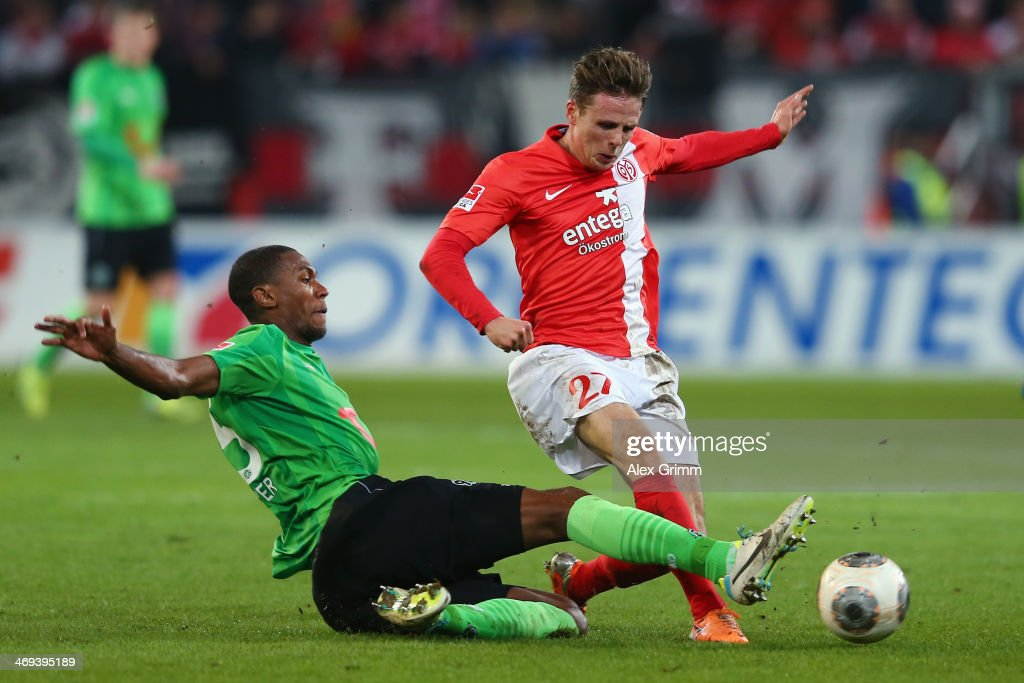 <a gi-track='captionPersonalityLinkClicked' href=/galleries/search?phrase=Nicolai+Mueller&family=editorial&specificpeople=2344337 ng-click='$event.stopPropagation()'>Nicolai Mueller</a> (R) of Mainz is challenged by Marcelo of Hannover during the Bundesliga match between 1. FSV Mainz 05 and Hannover 96 at Coface Arena on February 14, 2014 in Mainz, Germany.