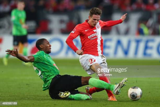 Nicolai Mueller of Mainz is challenged by Marcelo of Hannover during the Bundesliga match between 1 FSV Mainz 05 and Hannover 96 at Coface Arena on...