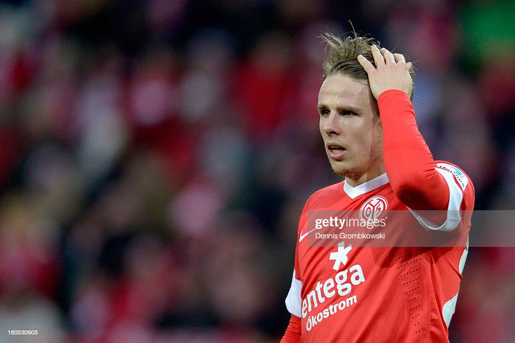 <a gi-track='captionPersonalityLinkClicked' href=/galleries/search?phrase=Nicolai+Mueller&family=editorial&specificpeople=2344337 ng-click='$event.stopPropagation()'>Nicolai Mueller</a> of Mainz reacts during the Bundesliga match between 1. FSV Mainz 05 and FC Bayern Muenchen at Coface Arena on February 2, 2013 in Mainz, Germany.