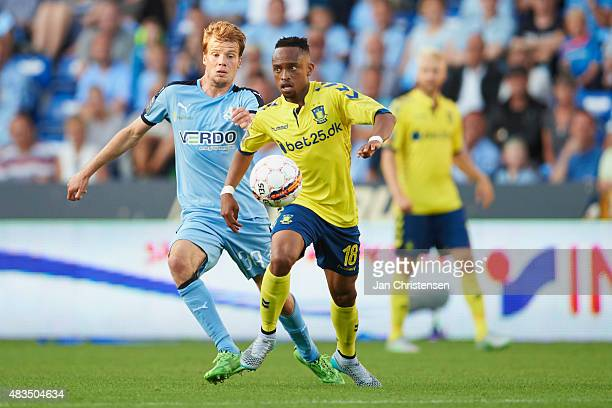 Nicolai Poulsen of Randers FC and Lebogang Phiri of Brondby IF compete for the ball during the Danish Alka Superliga match between Randers FC and...