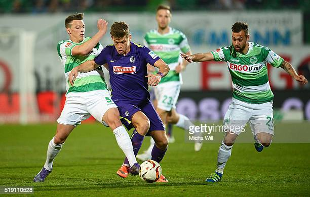 Nicolai Rapp of Fuerth Florian Niederlechner of Freiburg and Sebastian Heidinger of Fuerth compete for the ball during the Second Bundesliga match...