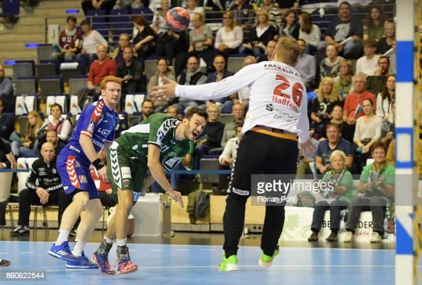 Nicolai Theilinger of HC Erlangen Petar Nenadic of Fuechse Berlin and Michael Hassferter of HC Erlangen during the game between Fuechse Berlin and...