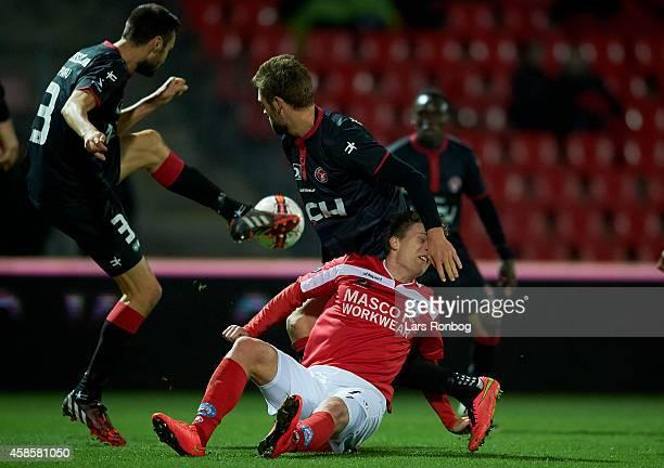 Nicolaj Agger of Silkeborg IF and Jim Larsen of FC Midtjylland and Tim Sparv of FC Midtjyllandcompete for the ball during the Danish Superliga match...