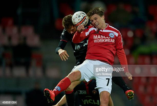 Nicolaj Agger of Silkeborg IF and Jim Larsen of FC Midtjylland compete for the ball during the Danish Superliga match between Silkeborg IF and FC...