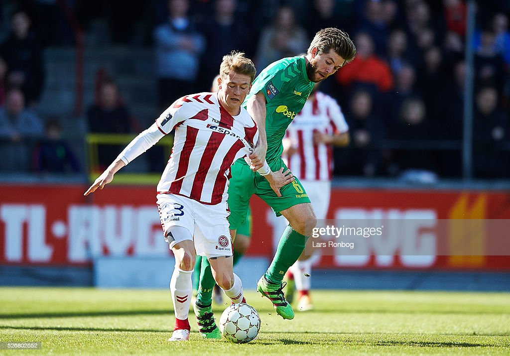 Nicolaj Thomsen of AaB Aalborg and Martin Ornskov of Brondby IF compete for the ball during the Danish Alka Superliga match between AaB Aalborg and Brondby IF at Nordjyske Arena on May 1, 2016 in Aalborg, Denmark.