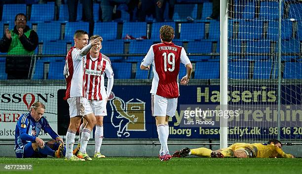 Nicolaj Thomsen of AaB Aalborg and team mate Thomas Enevoldsen celebrates after scoring their third goal during the UEFA Europa League match between...
