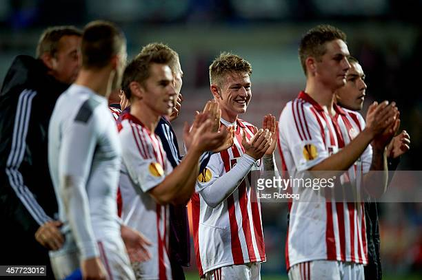 Nicolaj Thomsen of AaB Aalborg celebrate their victory after the UEFA Europa League match between AaB Aalborg and Dynamo Kyiv at Nordjyske Arena on...