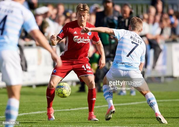 Nicolaj Thomsen of FC Copenhagen and Anders Holst of FC Helsingor compete for the ball during the Danish Alka Superliga match between FC Helsingor...