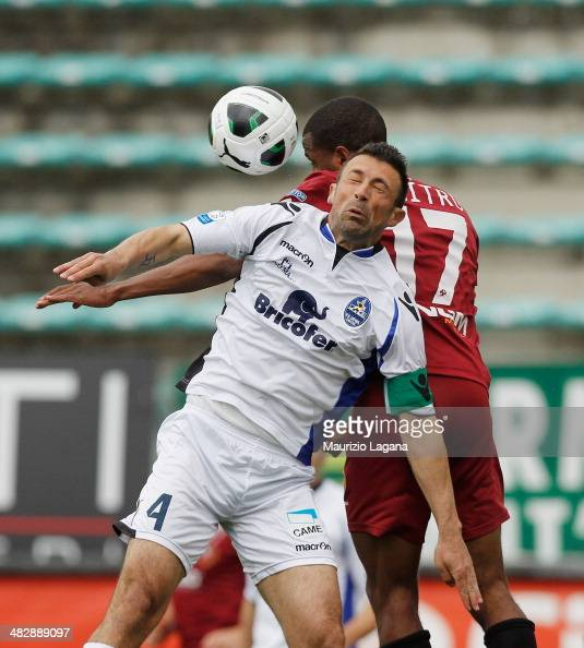 Nicolao Dumitru of Reggina competes for the ball in air with Marcello Cottafava of Latina during the Serie B match between Reggina Calcio and US...
