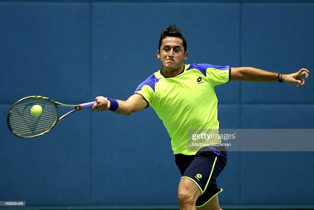 Nicolas Alamgro of Spain returns a shot to Go Soeda of Japan during the Shanghai Rolex Masters at the Qi Zhong Tennis Center on October 8, 2013 in Shanghai, China.