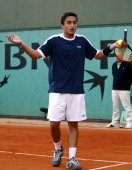 Nicolas Almagro gestures in disbelief at a line call in the second set of his five set match against Gustave Kuerten Kuerten won 75 76 16 36 75