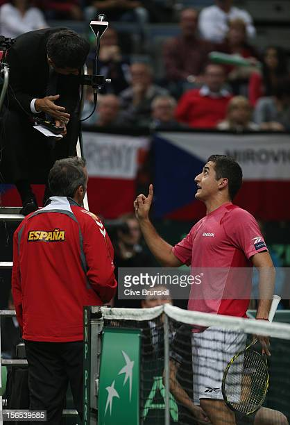 Nicolas Almagro of Spain and his team captain Alex Corretja make a point to umpire Carlos Ramos during his match against Tomas Berdych of Czech...