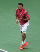 Nicolas Almagro of Spain celebrates a point against Tomas Berdych of Czech Republic during day one of the final Davis Cup match between Czech...