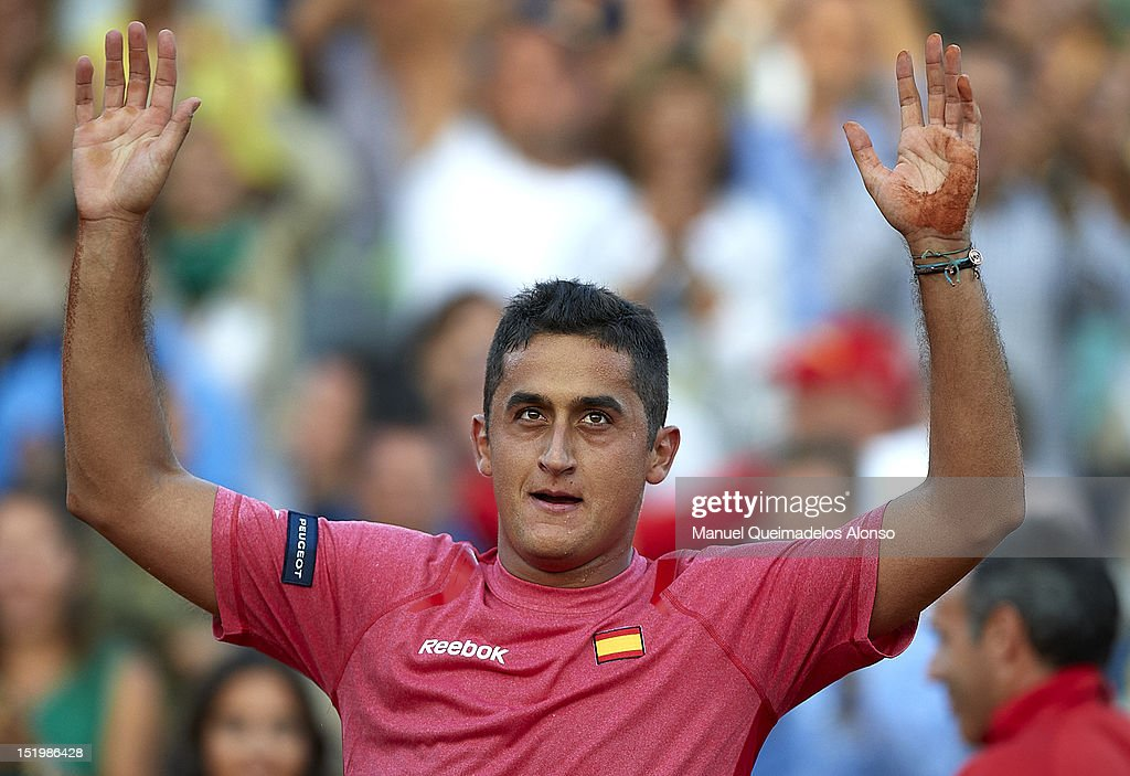 Nicolas Almagro of Spain celebrates his win over John Isner of the United States during day one of the semi final Davis Cup between Spain and the United States at the Parque Hermanos Castro on September 14, 2012 in Gijon, Spain.