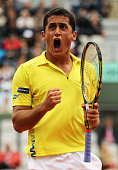 Nicolas Almagro of Spain celebrates in his men's singles fourth round match against Janko Tipsarevic of Serbia during day 9 of the French Open at...