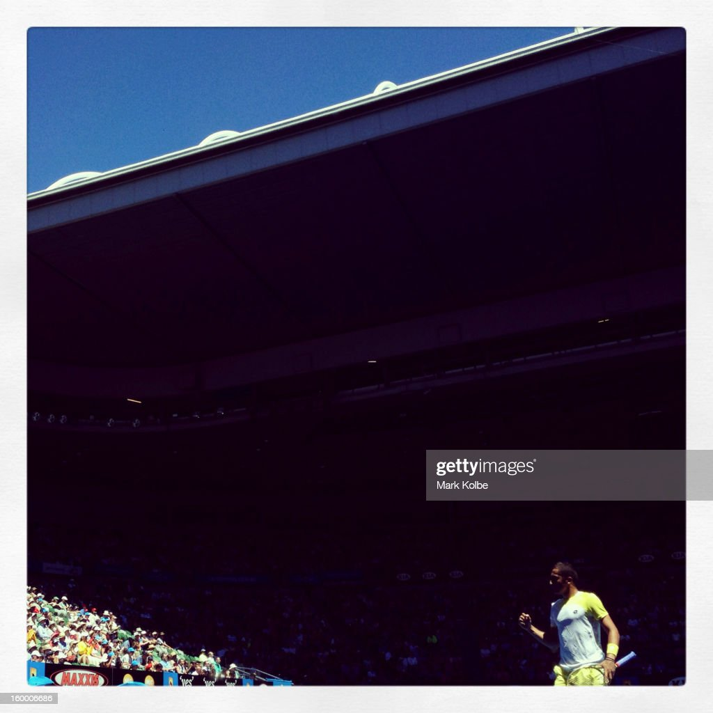 Nicolas Almagro of Spain celebrates winning a point in his Quarterfinal match against David Ferrer of Spain during day nine of the 2013 Australian...