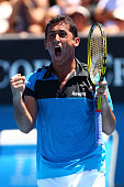 Nicolas Almagro of Spain celebrates winning a set in his third round match against Ivan Ljubicic of Croatia during day five of the 2011 Australian...