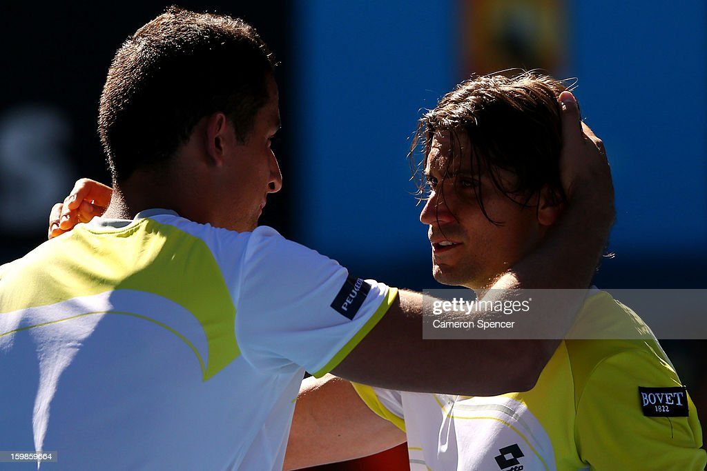 Nicolas Almagro of Spain congratulates David Ferrer of Spain on winning their Quarterfinal match during day nine of the 2013 Australian Open at Melbourne Park on January 22, 2013 in Melbourne, Australia.