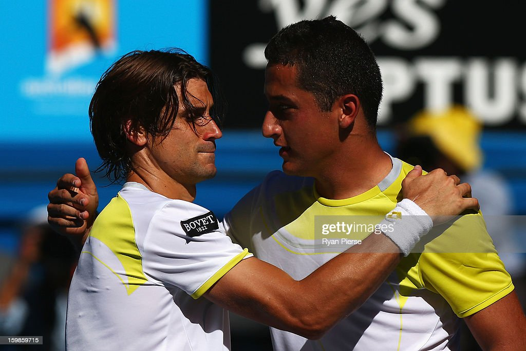 Nicolas Almagro (R)of Spain congratulates David Ferrer of Spain on winning their Quarterfinal match during day nine of the 2013 Australian Open at Melbourne Park on January 22, 2013 in Melbourne, Australia.