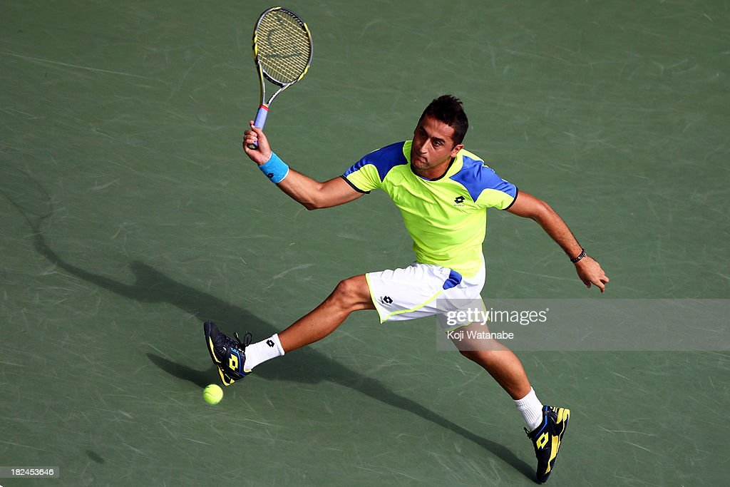 Nicolas Almagro of Spain in action during his men's first round match against Benjamin Becker of Germany during day one of the Rakuten Open at Ariake Colosseum on September 30, 2013 in Tokyo, Japan.