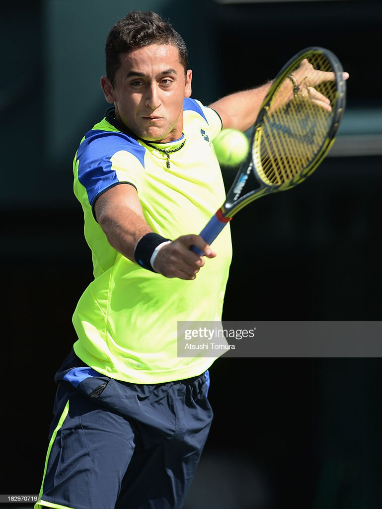 <a gi-track='captionPersonalityLinkClicked' href=/galleries/search?phrase=Nicolas+Almagro&family=editorial&specificpeople=553850 ng-click='$event.stopPropagation()'>Nicolas Almagro</a> of Spain in action during men's second round singles match against Horacio Zeballos of Argentina during day four of the Rakuten Open at Ariake Colosseum on October 3, 2013 in Tokyo, Japan.