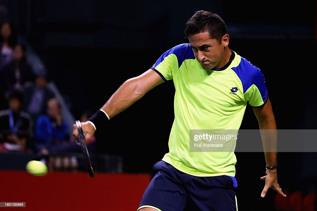 <a gi-track='captionPersonalityLinkClicked' href=/galleries/search?phrase=Nicolas+Almagro&family=editorial&specificpeople=553850 ng-click='$event.stopPropagation()'>Nicolas Almagro</a> of Spain in action during men's singles semi final match against Juan Martin Del Potro of Argentina during day six of the Rakuten Open at Ariake Colosseum on October 5, 2013 in Tokyo, Japan.
