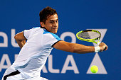 Nicolas Almagro of Spain in action in his match against Stanislas Wawrinka of Switzerland during day one of the Mubadala World Tennis Championship at...