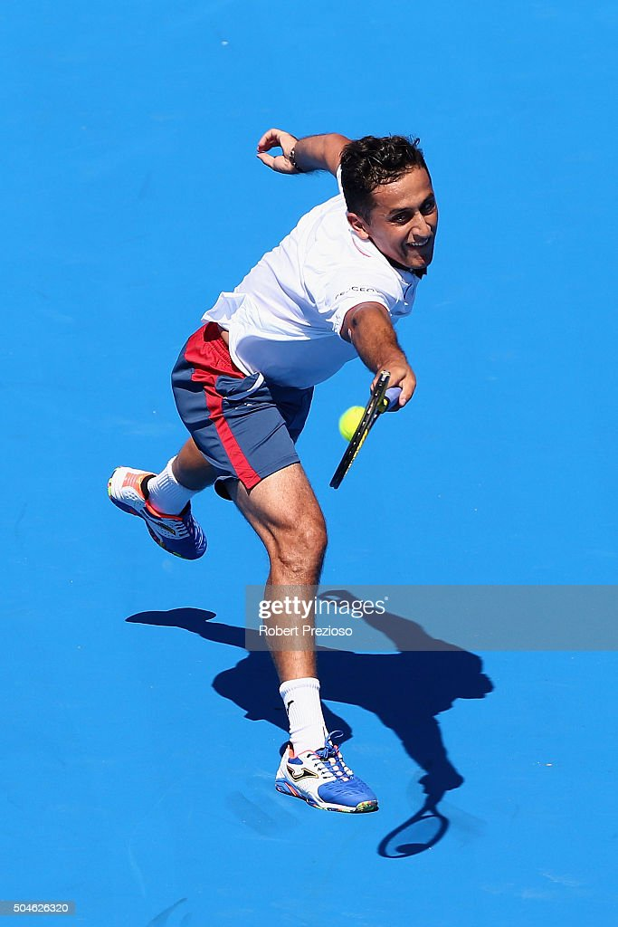 Nicolas Almagro of Spain plays a backhand in his match against Paul-Henri Mathieu of France during day one of the 2016 Kooyong Classic at Kooyong on January 12, 2016 in Melbourne, Australia.