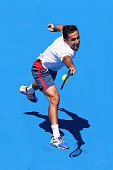 Nicolas Almagro of Spain plays a backhand in his match against PaulHenri Mathieu of France during day one of the 2016 Kooyong Classic at Kooyong on...