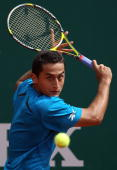 Nicolas Almagro of Spain plays a backhand in his match against Simon Greul of Germany during day one of the ATP Masters Series at the Monte Carlo...
