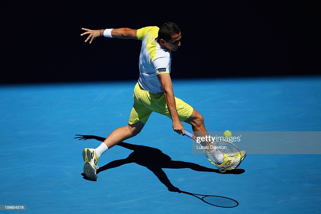 Nicolas Almagro of Spain plays a backhand in his Quarterfinal match against David Ferrer of Spain during day nine of the 2013 Australian Open at Melbourne Park on January 22, 2013 in Melbourne, Australia.