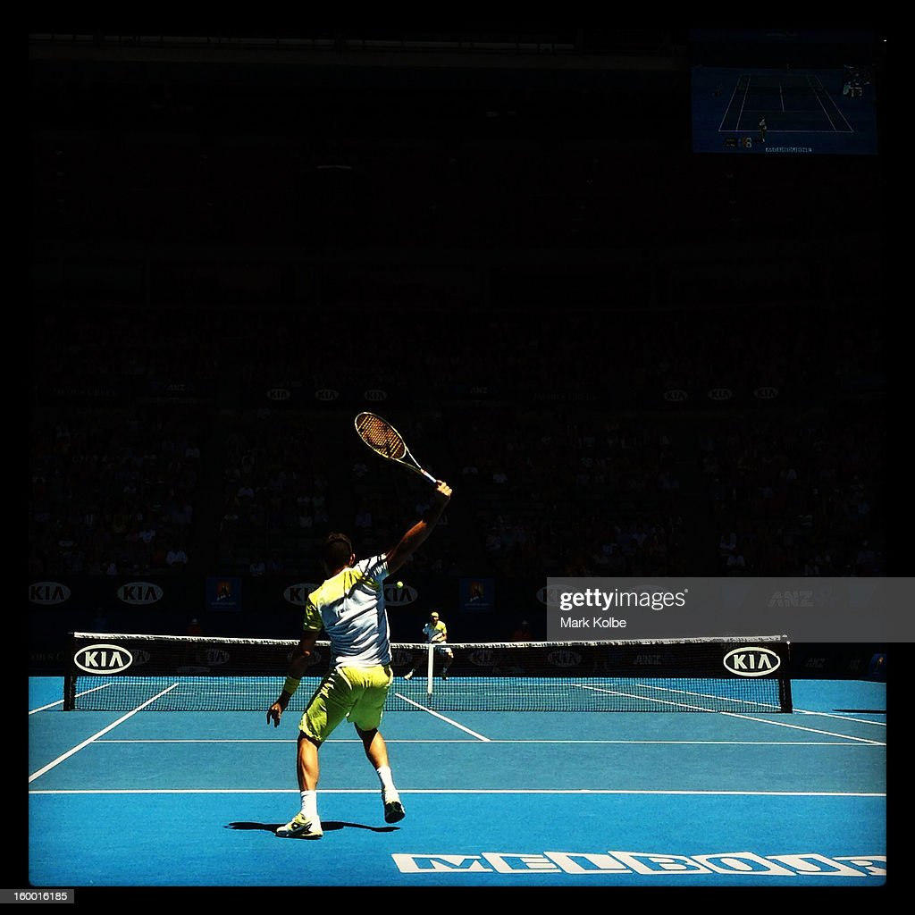 Nicolas Almagro of Spain plays a backhand in his Quarterfinal match against <a gi-track='captionPersonalityLinkClicked' href=/galleries/search?phrase=David+Ferrer&family=editorial&specificpeople=208197 ng-click='$event.stopPropagation()'>David Ferrer</a> of Spain during day nine of the 2013 Australian Open at Melbourne Park on January 22, 2013 in Melbourne, Australia.