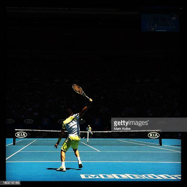 Nicolas Almagro of Spain plays a backhand in his Quarterfinal match against David Ferrer of Spain during day nine of the 2013 Australian Open at...