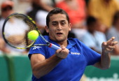 Nicolas Almagro of Spain plays a forehand during his match against Adrian Mannarino of France on day four of the Heineken Open at the ASB Tennis...
