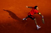 Nicolas Almagro of Spain plays a forehand during the men's singles quarter final match between Rafael Nadal of Spain and Nicolas Almagro of Spain at...