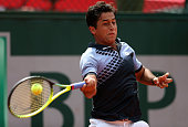 Nicolas Almagro of Spain plays a forehand in his Men's Singles match against Alexandr Dolgopolov of Ukraine on day three of the 2015 French Open at...