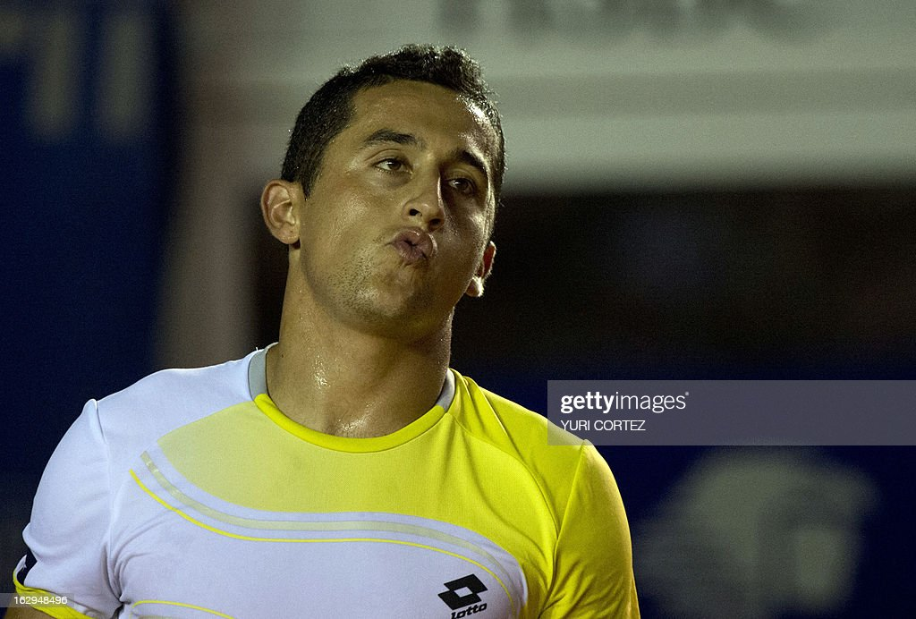 Nicolas Almagro of Spain reacts after being defecting by compatriot Rafael Nadal during their semi-final Mexico ATP Open men's single tennis match in Acapulco, Guerrero state on March 1, 2013. AFP PHOTO/ Yuri CORTEZ