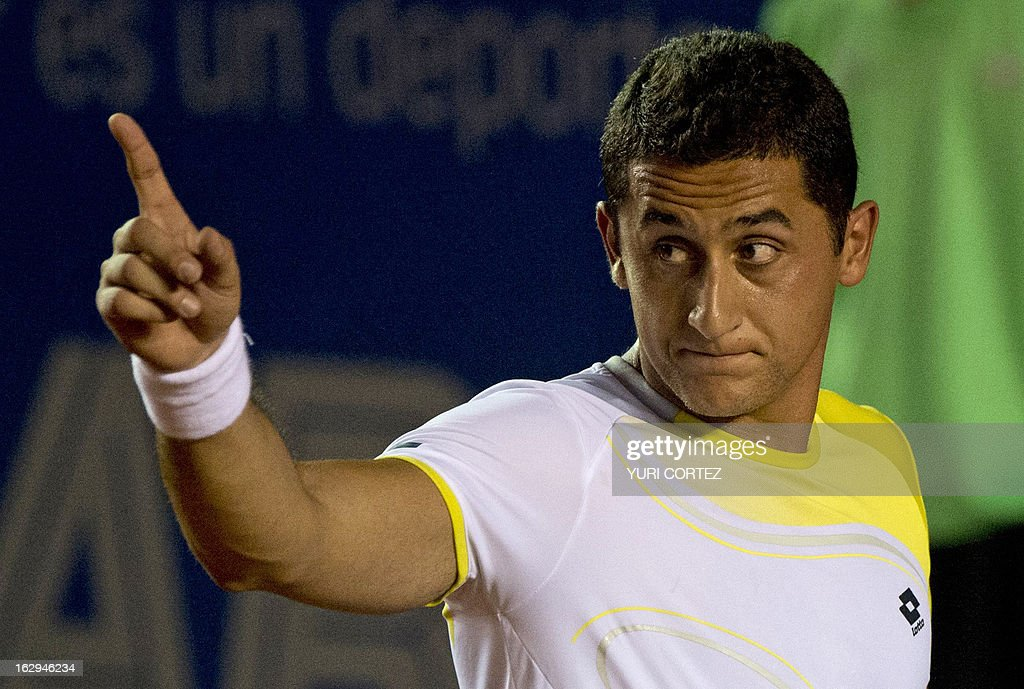 Nicolas Almagro of Spain reacts while competing with his compatriot Rafael Nadal during their semi-final Mexico ATP Open men's single tennis match, in Acapulco, Guerrero state on March 1, 2013. AFP PHOTO/ Yuri CORTEZ