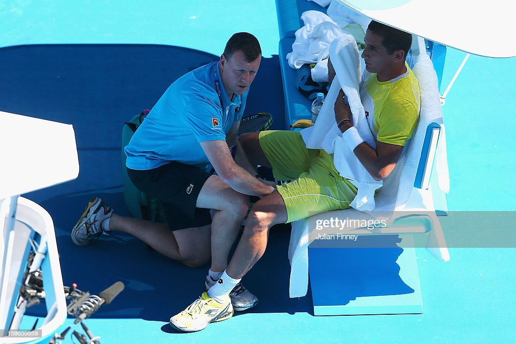 Nicolas Almagro of Spain receives medical attention in his Quarterfinal match against David Ferrer of Spain during day nine of the 2013 Australian Open at Melbourne Park on January 22, 2013 in Melbourne, Australia.
