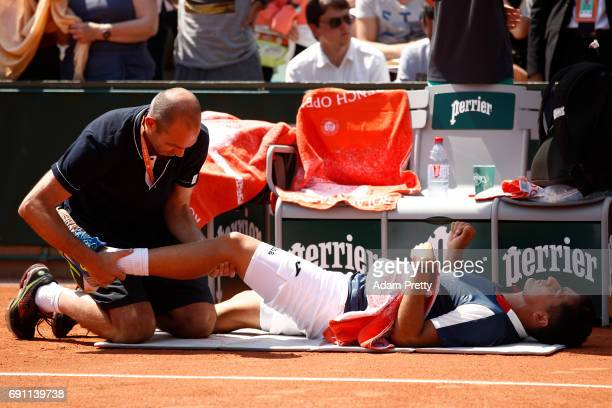 Nicolas Almagro of Spain receives treatment during the men's singles second round match against Juan Martin Del Potro of Argentina on day five of the...