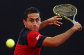 Nicolas Almagro of Spain returns a backhand during his semi final match against Fernando Verdasco of Spain during the betathome German Open Tennis...