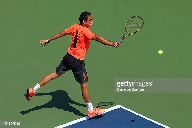Nicolas Almagro of Spain returns a shot against Jack Sock of the United States during their men's singles third round match on Day Six of the 2012 US...